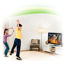 Two kids playing with the Xbox 360 Kinect